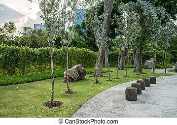 Green urban city park. Trees, grass, footway - Green urban ...