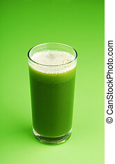 Green vegetable smoothie on green background