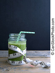 Green vegetable smoothie with background space