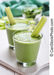 Green vegetable smoothie with celery and spinach on wooden...