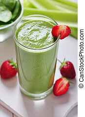 Green vegetable smoothie with celery and strawberry on ...
