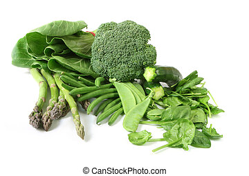 Green vegetables on white background. Includes asparagus, zucchini or courgette, broccoli, bok choy, beans, spinach, and snow peas.