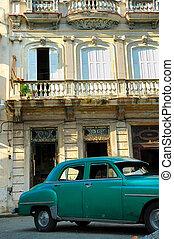 Green vintage car parked in Havana street