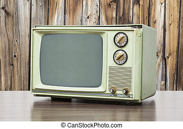 Green Vintage Television with Old Wood Wall