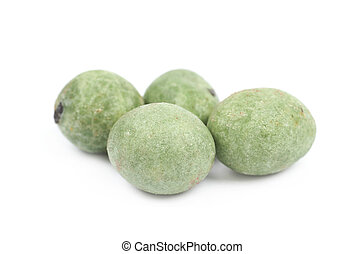Green wasabi coated peanuts isolated