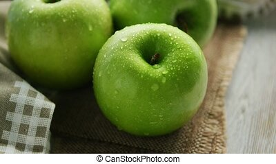 Green wet apples in drops