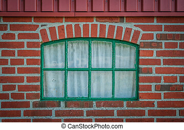 Green window on a brick wall