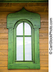 Green window on the wooden house