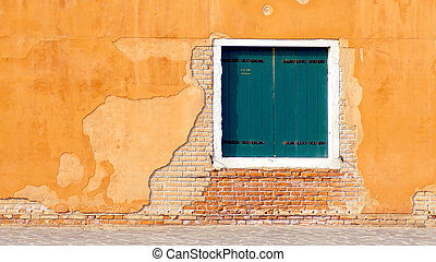 green Window on yellow and brick wall building