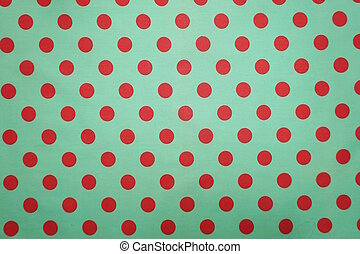 Green with pink polka dot pattern background