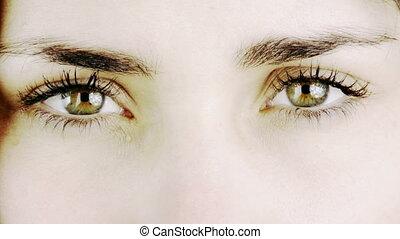green woman eyes close up