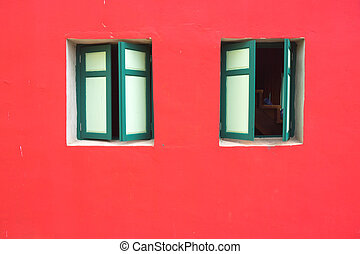 green wood window on a pink wall
