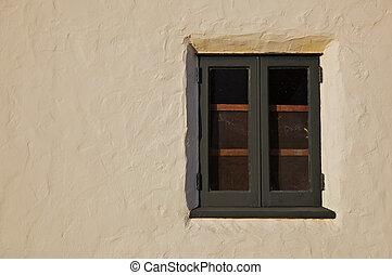 Green wood window stucco wall
