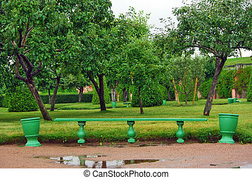 Green wooden bench in the garden