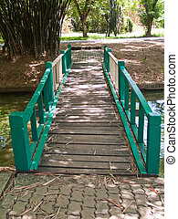 Green wooden bridge