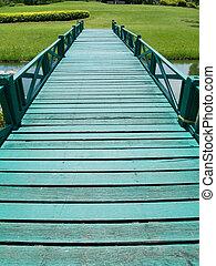Green wooden bridge