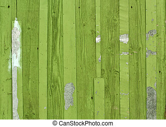 Green wooden fence with metal plates.