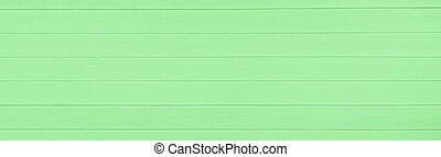 Green wooden texture background. Copy space, text place. Wood finish material shop. Natural banner. Painted plank timber. Wall lining. Rustic mockup. Indoor interior. Horizontal lines. Spring color