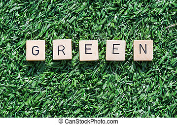 Green word with wood letters on synthetic grass