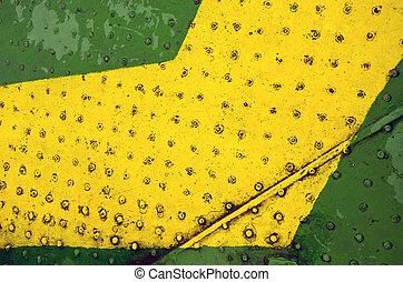 Green yellow paint metal floor closeup background