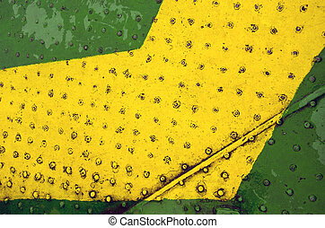Green yellow paint metal floor closeup background
