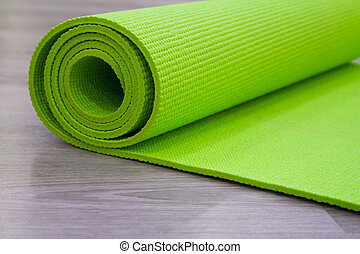 Green yoga mat - Complement stretching exercise. Yoga mat