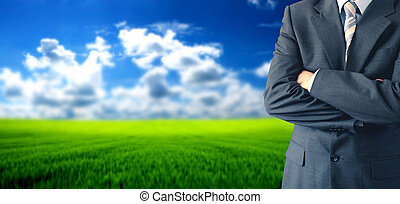 Greenfield investment concept - businessman in front of...