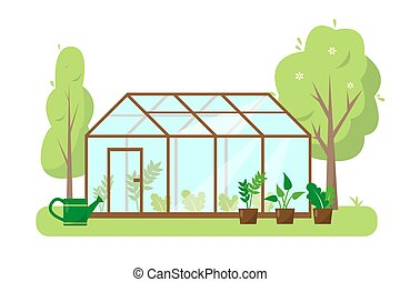 Greenhouse with plants and trees in garden. Spring or summer...