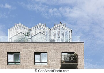 Greenhouses on a roof of a building in Denmark
