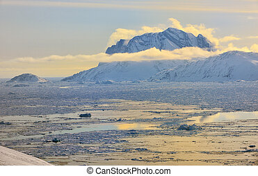 Greenland Fjord with Sea Ice in spring time