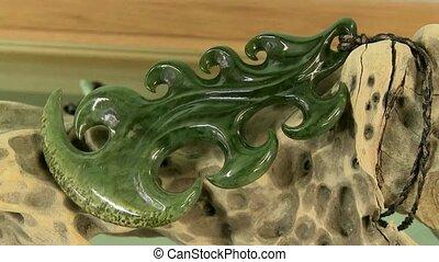 Greenstone carving on display. - Greenstone Maori art on...