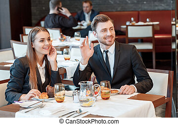 Greeting acquaintances during the business lunch