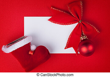 greeting card and christmas decoration on red background