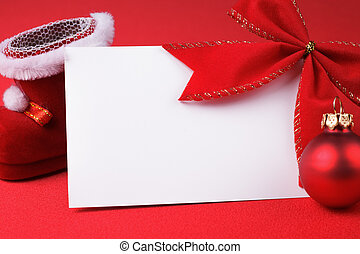 greeting card and christmas decoration over red background