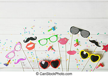 Greeting card for carnival party on wooden background.
