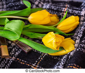 Greeting card, holiday gift, Yellow tulips on a plaid weave and chocolate
