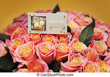 Greeting card on a bouquet of roses