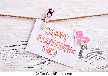 Greeting card on wooden backdrop.