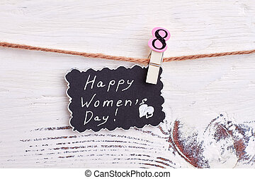 Greeting card on wooden surface.