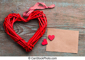 greeting card with a red heart and space for text on a wooden background
