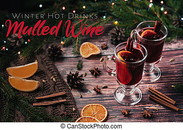 hot winter drink mulled wine in glasses with Christmas decor
