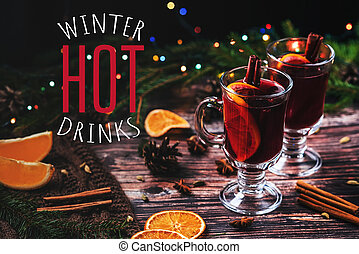 mulled wine in glasses with Christmas decor with the inscription Winter Hot Drinks