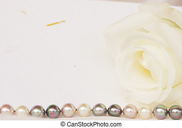 greeting card with rose and pearls