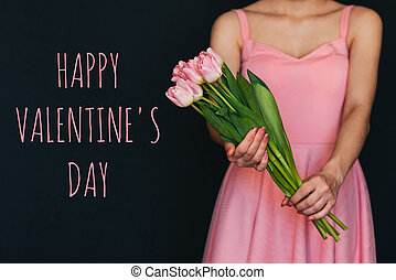 Greeting card with the inscription Happy valentine's day. Bouquet of pink tulips