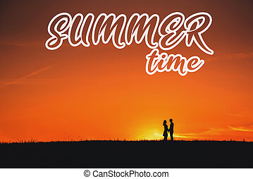 Greeting card with the inscription time of summer. A couple in love hugging on the background of an sunset