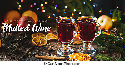 traditional winter spicy and warm drink mulled wine in glasses on the background of Christmas decor
