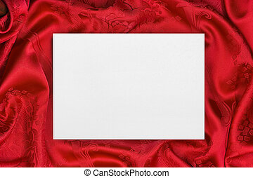 Greeting paper card on red cloth