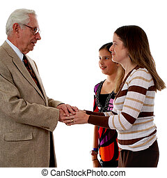 Greeting Pastor - Pastor greeting his parishioners after...