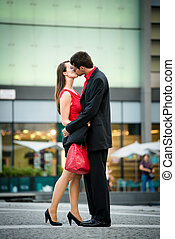 Greeting - young couple in red - Young business couple...