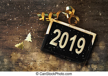 greetings 2019 on wooden table